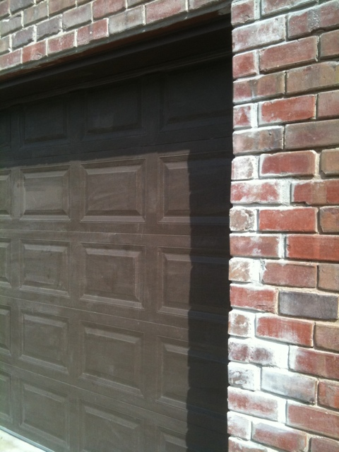 Poor Craftsmanship on a brick garage door opening