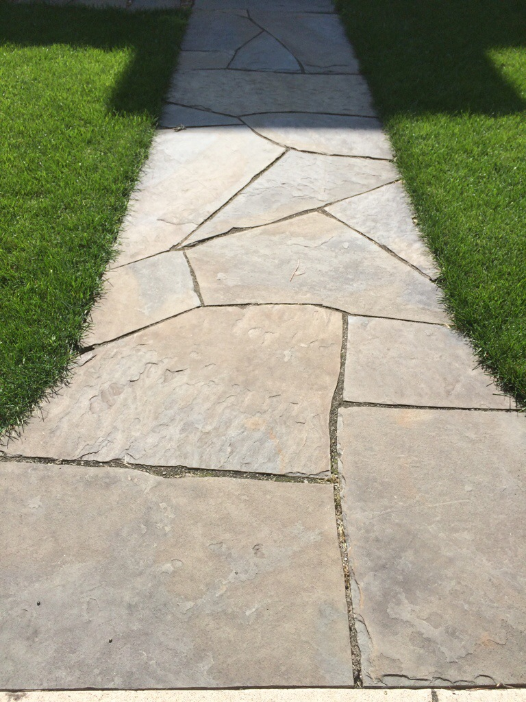 Blue stone sidewalk laid correctly over twenty years strong